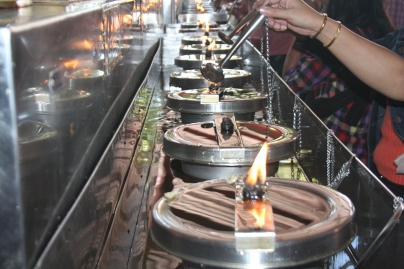 Fill the oil to Candle  to extend your long life in Buddhist Temple